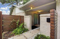 Modern cedar fence. Entryway.