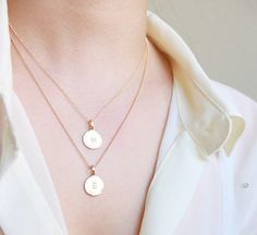 I want a necklace like this so badly, both my babies first initial!