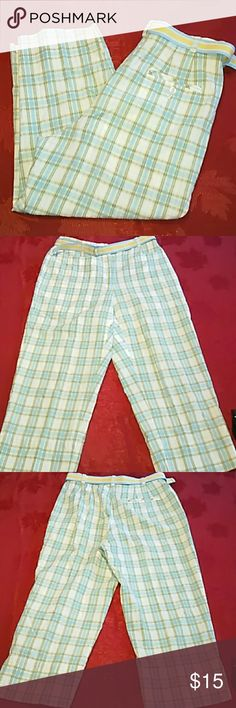 Liz Claiborne Liz Golf Capri Pants These Liz golf capri pants by Liz Claiborne are size 8 and are made of 100% cotton. They are primarily blue yellow and white and feature a blue and white belt. They have an 11 inch rise in a 22 inch inseam. Liz Claiborne Pants Capris