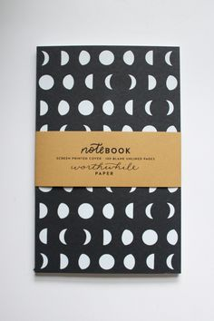 This phases of the Moon notebook is sourced and made in the USA. Screen printed cover. Hand illustrated. Holds 100 unlined blank pages made of recycled paper for you to add a poem, drawing, or journal