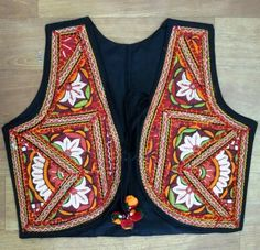 These Jackets are comprised of Kutchiwork, Pakko embroidered work, vintage ethnic flower patchwork pakkowork, Mirrorwork Pakkowork with Colorful Pompom. For bulk Inqury ( Brinda Desai (Whatsapp No. +91 9724984661 for immediate assistance)