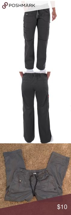 """Dickies Gen Flex Youtility Scrub Pants """"Dickies Women's 857455 Generation Flex contemporary youtility low-rise scrub pant features an all around elastic waistband with a drawstring and wide belt loops. For storage there are two back pockets and front shaped pockets with sectional pockets. The right sectional pocket has a snap closure, and left has an ID bungee loop. Two cargo pockets. Multi-needle contrast top-stitching. Knee darts and straight leg"""".  Some fading but still in very good…"""