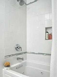 Simple white tiles are inexpensive and can be spiced up with a thin band of decorative tiles as an accent.