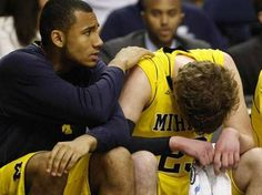 University of Michigan's Evan Smotrycz is comforted by Jon Horford after Smotrycz made a key turn over in the final seconds against Ohio loosing 65-60 in the NCAA Tournament second round game Friday. March 16, 2012 at the Bridgestone Arena in Nashville Tenn. Ohio defeated the University of MIchigan 65- 60. #marchmadness