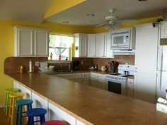 Large breakfast bar in kitchen.