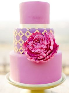 I know this is a cake but i love this color scheme and the pattern on the middle tier; gold, purple and fuchsia - all its missing is some turquoise!