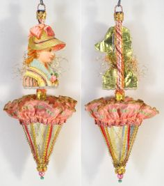 "Victorian Lady in Bonnet on Glass Parasol with Peach Ruffle by Star Dresden Ornaments.  Description: ""This one-of-a-kind ornament is made almost exclusively with antique and early vintage materials, including old glass ornament(s) with beautiful patina; detailed embossed scrap(s) (most of them predate the 1900s & are meticulously backed with early papers and/or old tinsel); a variety of old fabric to include chenille, lace, ribbon & metallic trims; old decorative tinsel...& other…"