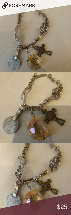 """Beautiful Mixed Metals and Charm Bracelet Silver, Gold Ornate Bracelet With Vintage Coin, Champagne Color Crystal and Cross Charm with J inital It looks very old, with ornate silver brackets. 7"""" long Jewelry Bracelets"""