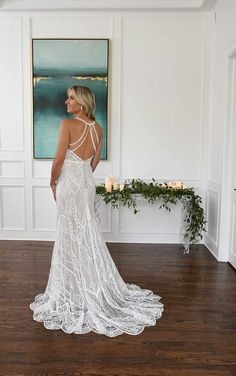 This striking sheath silhouette with a unique, stunning graphic lace pattern. Covered in strong linear details, a light shimmer throughout the silhouette creates an intense visual effect with your every move. A V-neckline and thin straps balance the look with a fresh, classic décolletage as they follow into a strappy open back statement that will have all eyes on you at every angle. Finally, the slight train with scalloped edging completes the look with a manageable yet breathtaking finish. Wedding Dress Pictures, Dream Wedding Dresses, Designer Wedding Dresses, Wedding Gowns, Essense Of Australia Wedding Dresses, Simple Gowns, Sheath Wedding Gown, Dress Out, White Gowns