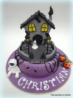Cute haunted house halloween cake with cute mummy ghost and