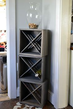 Love this wine rack idea, complete with pretty storage for the corks on top! Can't find any instructions though...