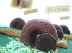 He is Risen Snack - I made these for the Sunday school classes last year. Made my own green icing for the graham crackers, then placed a chocolate covered Oreo in front of a chocolate doughnut that had one end cut off to make it stand up.