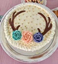 Vintage, boho baby shower deer antler and roses cake. Buttercream with modeling chocolate antlers.