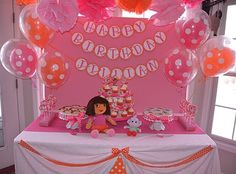 putting her dora stuffed animals out on food/dessert/gift table