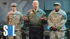 Alien Attack Cold Open - SNL. President Donald Trump (Alec Baldwin) addresses members of the military (Kenan Thompson, Kyle Mooney, Aidy Bryant, Leslie Jones, Sasheer Zamata, Beck Bennett, Alex Moffat, Kate McKinnon) during an alien invasion.