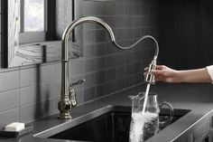 Artifacts Single-Hole Kitchen Sink Faucet with Pull-Down Spout, DockNetik® Magnetic Docking System, and Sprayhead Featuring Sweep®, ProMotion™, MasterClean™ and BerrySoft® Spray Kohler Artifacts, Low Sideboard, Campaign Dresser, Soapstone Kitchen, Kitchen Words, Black Kitchen Faucets, Glass Front Cabinets, Kitchen Colour Schemes, Vintage Jars