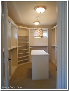 Love the idea of having a built in island in the closet for storage etc.