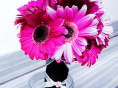 """Hot & Light Pink Gerbera Daisy bridal bouquet with bling accents wrapped in black satin with a sparkly silver """"corset"""" wrap"""