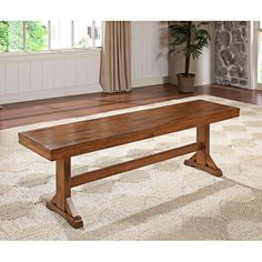 Detail-rich, the trestle-inspired base of this transitional wood bench complements a rich antique brown finish.