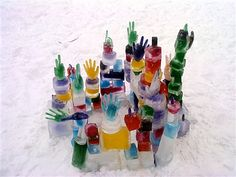 Using rubber gloves to make winter ice and snow sculptures is a great winter outdoor activity for kids