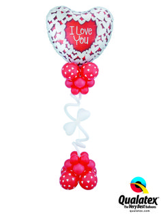 This sparkly and curly balloon design can be used as a centerpiece or delivered as a gift! Find a balloon professional near you. #qualatex #balloon #heart #valentines