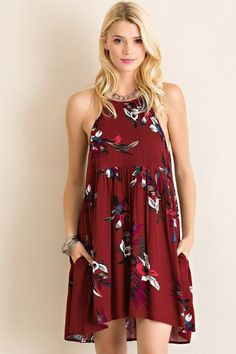 Fabulous Summer Dress in Crimson featuring a floral/hummingbird print. Slight high-low style with keyhole back and single button at nape of neck. Non-sheer and lightweight. 100% Rayon. Model is wearin