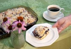 Shaking mulberries down out of the tree is an old summer tradition. Using them in mulberry streusel coffee cake could be a new summer tradition.