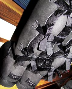 These are the ones I want over all uggs! Tall black with 3 bows!!!
