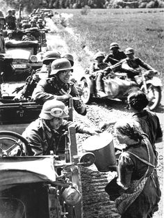 Latvian women giving water to a German column. At the beginning of the war, Wehrmacht soldier were seen as liberators by many citizen of Eastern European countries after some very rough years of Stalinism in the 30s.