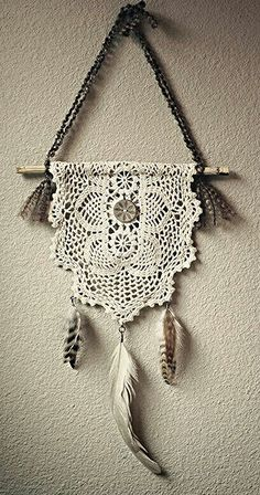Simple. I am not a fan of the feathers, but a doily hung over a stick is pretty…