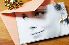 Such a cute way to gift earrings! Make a copy of a portrait of the recipient, then pierce stud earrings through one or both ears in the photograph. Secure the earrings by placing the backs on them. This is a great way to personalize and surprise!