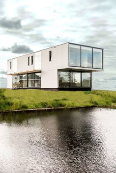 Wonderful Villa Designed for a Young Couple Located on the Shore of a Lake in Heerenveen, the Netherlands