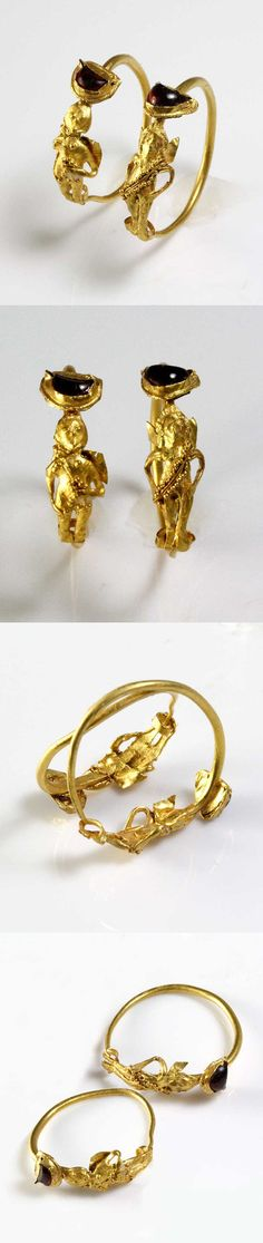 A Pair of Gold & Garnet Earrings of Eros, Hellenistic Period, ca 2nd - 1st century B.C.