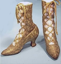 c. 1900 RARE Gold Lame Brocade Open Front Evening Boots. Old gold lame floral brocade with fully open front tied up with matching old laces (seem to be original as they match perfectly).  White kid leather interior. 6 images of it can be seen at http://www.antiquedress.com/item1760.htm#