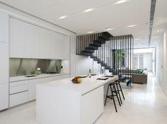 White kitchen island suspended staircase