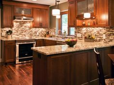 Tiled Kitchen Backsplash Tips Tiled : Kitchen Remodeling Idea With U Shaped Mahogany Kitchen Cabinet Designed With Granite Top And Brown Mosaic Tile Backsplash Combine With Small White Drum Lampshades And Dark Brown Wood Laminate Floor