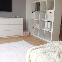 wood floors, gray walls, white furniture. I've actually been wanting that dresser and those shelves!