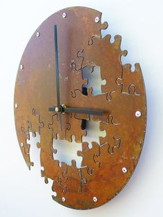 DIY - like the idea of using old metal to make a clock with screws in place of the numbers.