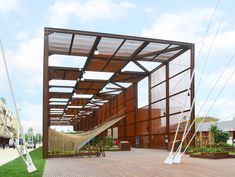 brazil pavilion at expo 2015 by studio arthur casas defined by tensile netted plane