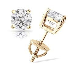 Elegant and Stylish 1/4 cttw Round Diamond 4-Prong Stud Earrings in 14K Yellow Gold with Screw Backs (J-K Color, I2-I3 Clarity). These timeless diamond stud earrings feature two carefully matched 0.25ct TDW diamonds in classic four-prong basket and secures with screw backs. Made in the United States.   Limited Quantities Available. Offer valid while supplies last. This item will be gift wrapped in a Luxurious Cherrywood Gift Box. In addition...