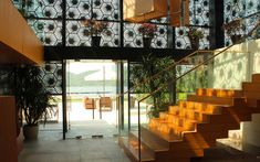 We are a global and creative design studio in Geneva, Tokyo and Beijing. Restaurant Facade, Patterned Wall, Wooden Stairs, Wall Patterns, Flowers Garden, Japanese Food, Furnitures, Garden Furniture, Glass Door