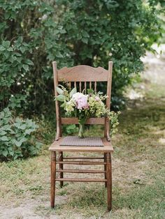 A lovely shot of the bouquet propped up on a vintage chair. Colleen Riley Photography .