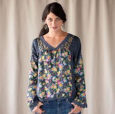 """Confetti dots besprinkle vibrant florals, spewing out of bounds onto solid insets. In soft and sensuous silk with lace trim at V-neck, sleeves and hemline. Machine wash. Imported. Exclusive. Sizes S (6 to 8), M (10 to 12), L (14), XL (16). Approx. 26""""L."""