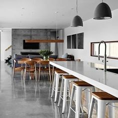 Instagram photo by interiorsme - Loving the look of this open plan kitchen, dining room and living room! Regram @caesarstoneau #charcoal #grey #whitekitchen #kitchen #concretefeaturewall #concrete #concretefloors #timber #pendentlighting #timberdetailing #white #caesarstonebenchtops #interiors #interiordesign #designer #style #ime #interiorsme