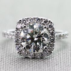 2.01 Carat, Round Diamond, J Color, SI2 Clarity, Very Good Cut, GIA, in a Diamond Crown Halo Engagement Ring in White Gold (3/4 Carats tdw.)
