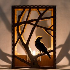 Raven in Branches laser cut wood candle luminary. Tea light candle inc… - Wood Workings Laser Art, Laser Cut Wood, Laser Cutting, Tealight Candle Holders, Candle Lanterns, Acrylic Cutter, Diy Home Decor Projects, Wood Design, Wood Art