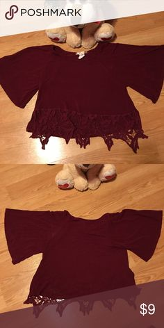 "Cute top Burgundy color. Lace at bottom. Side slits. Wide sleeves. 96% rayon 4% spandex. 18"" from shoulder to end of lace and 18"" in back too. armpit to armpit 18"". Danbee Tops Tees - Short Sleeve"