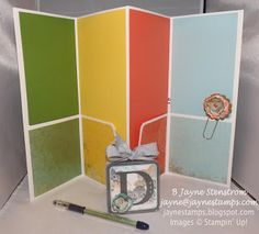 "Inside of altered file folder (with ""This 'n That"" designer series paper)."