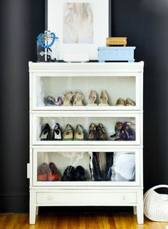 I have seen this a few times, using a glass display cabinet as a shoe organizer since shoes are pretty enough to display.