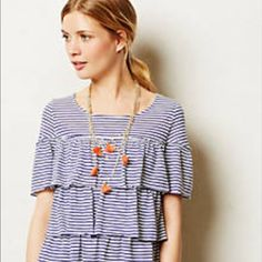 Postmark Layered Ruffle Top from Anthropologie Super cute top for spring and summer. I'm second owner, so listing in VGUC. No rips or stains that I can see.  Smoke free/Pet friendly home Anthropologie Tops Tees - Short Sleeve